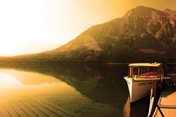 Forest fire smoke and haze over a boat docked in Glacier Montana.