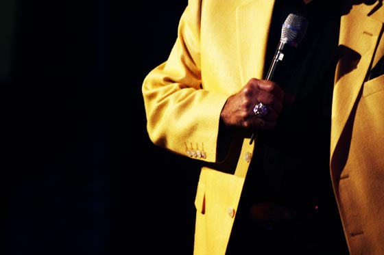 Mickey Gilley's big ring and yellow blazer during a concert in Branson, Missouri.
