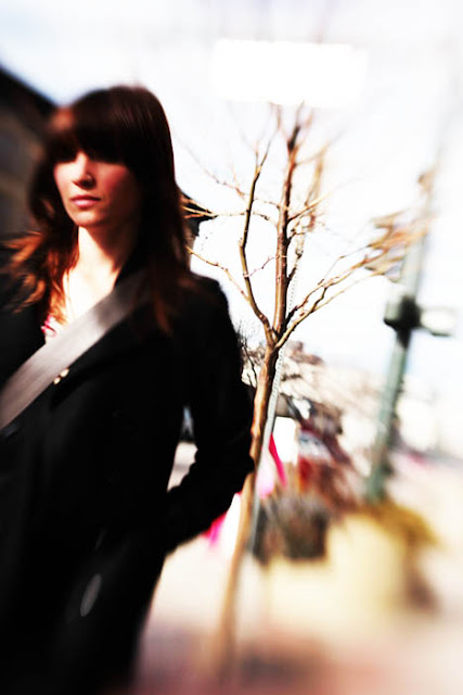 A Denver girl with bangs walking down Broadway. Created using a Lensbaby Composer lens.