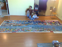Another Family Photo with the completed World&#39;s Largest Puzzle