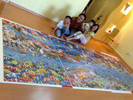 Solskjaer, Seraphina, Joyce & Andrew with completed World's Largest Puzzle