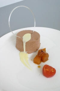 ... with candied tomato, caramelized apple and white chocolate sauce