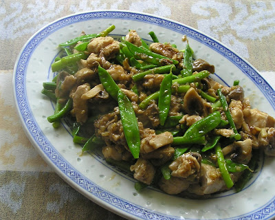 Stir-Fried Fish with Snow Peas, Mushrooms and Garlic Scapes