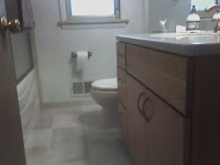 full bath with tile floor and walls