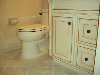 diagonal ceramic tile with new vanity and Kohler toilet