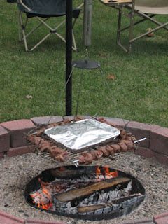 Automatic chef rotating campfire grill
