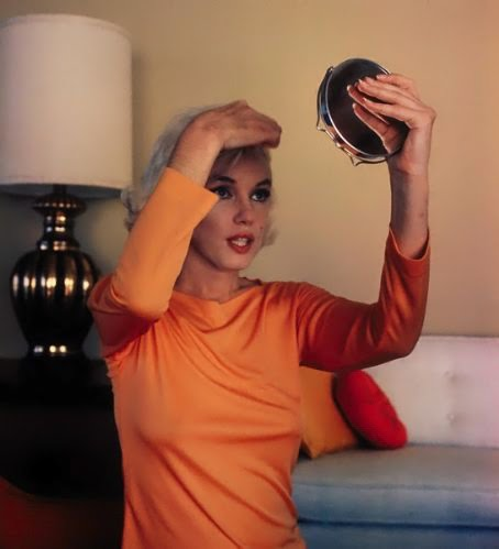 Marilyn Monroe doing her hair