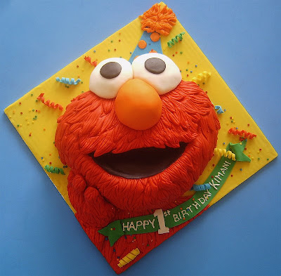 A big happy Elmo Birthday cake to help celebrate a little boys first