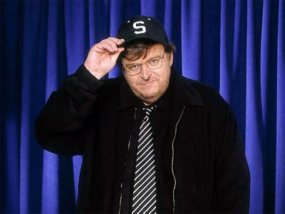Michael Moore Hammers Wolf Blizer - CNN Milks The Damage