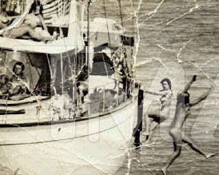 JFK and Ted Kennedy on a yacht with naked sexy women?