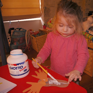 toddler craft gluing Rudolph