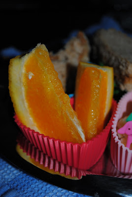orange wedges in muffin tin meal