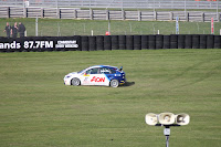 BTCC driver Tom Onslow-Cole takes to the grass