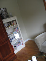 After: a calm serene corner with a pretty bookshelf and photos