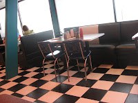 Love the checkerboard floor and shiny naugahyde.