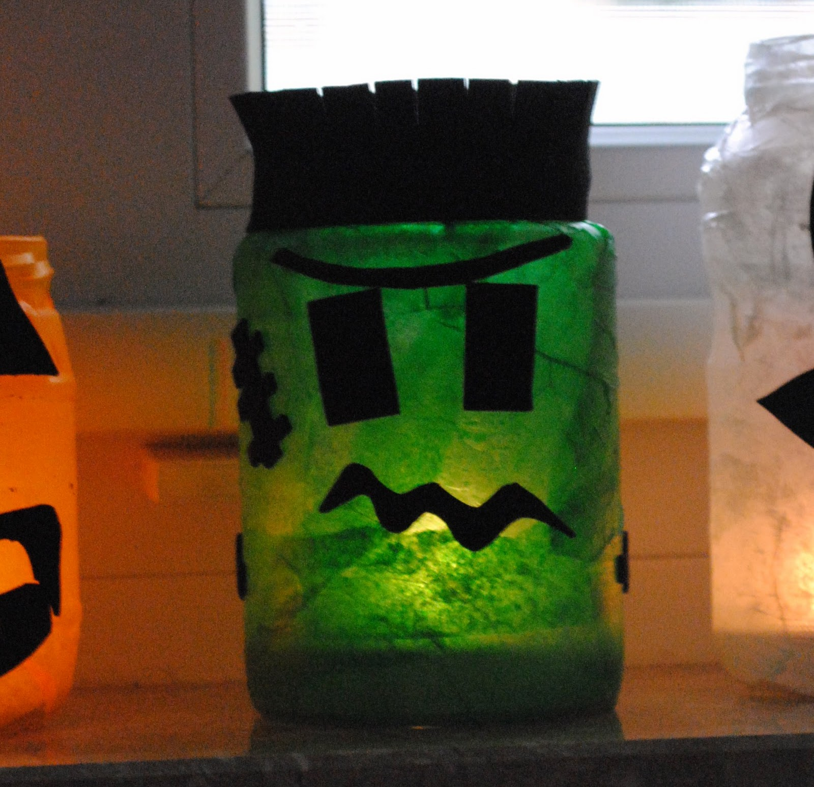 halloween monster decorations upcycle mod podge luminaries kid crafts halloween decorations halloween boy crafts