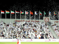 Al Sadd fans show their support for their time by throwing up white paper