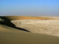 Sand dunes form a semi-circle