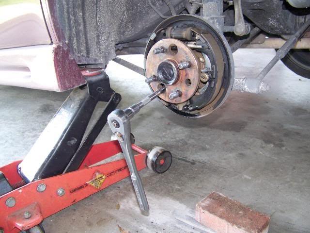 how to change rear shocks on 2005 toyota corolla