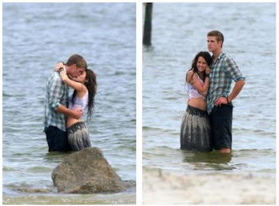Liam Hemsworth kisses Miley cyrus