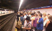 . their valuable strike time to bring you their personal train. (madrid metro crowded platform)