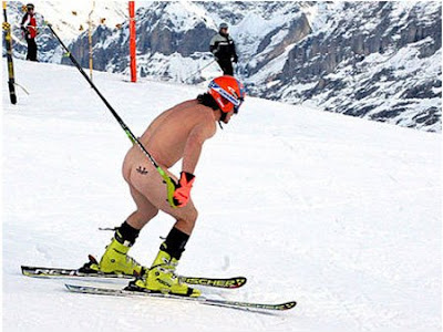 I only have one example of a skier with a tattoo. There were loads but this