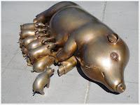 golden pig with eleven piglets