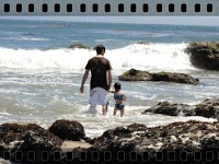 Dad and Trinity in the waves