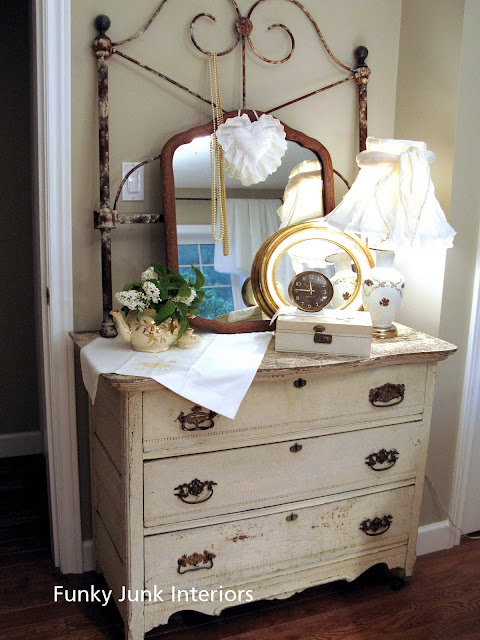 vintage dresser with rusty headboard / White Trash Bedroom reveal with old door and gate headboard, via FunkyJunkInteriors.net