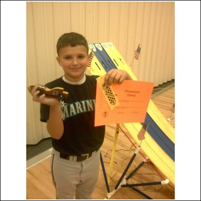 Forrest had his FIRST Pinewood Derby last night. :)  He was so proud of his car--he won two races.