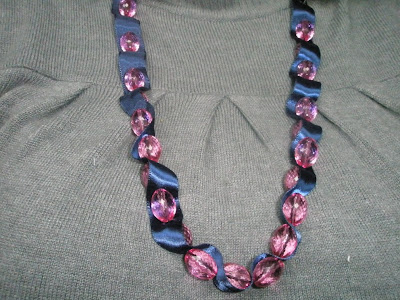 pink ribbon with stardust silver sparkling beads beads ribbon necklace with needle like blue cricket designs