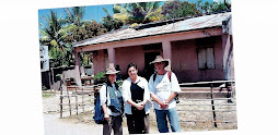 Rae, Damien and PhD student, Sue Downie, in front of the 'Chinese House', Balibo, 30 August 1999