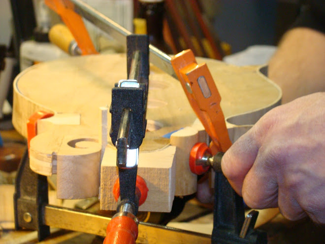 DETAIL OF DANEL SEABOLT CLAMPING THE MANDOLIN THAT WILL BE FEATURED IN AN UPCOMING MUSEUM SHOW