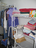hanging clothes and wire shelves