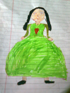 crayon drawing  on lined paper by a 5-year old child of a dark-haired girl with pig-tails in a pretty green dress