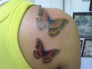 sexy girl with two design butterfly tattoo on the upper back body