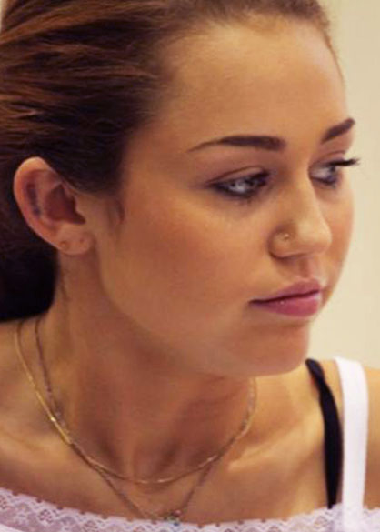Star Tattoo Ear. Miley cyrus new ear tattoo