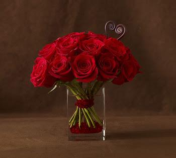 Rosas rojas con tarjetero
