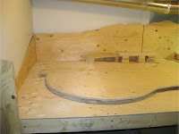 Left benchwork track risers