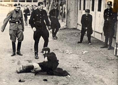 German+policemen+tormenting+a+Jew HOLOCAUST: TIMELINE
