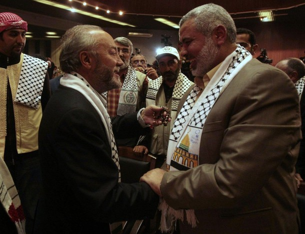 [Left-wing+British+politician+George+Galloway+(L)+is+greeted+by+senior+Hamas+leader+Ismail+Hanyieh+during+a+rally+honouring+international+peace+activists+in+Gaza+City+January+7,+2010.jpg]