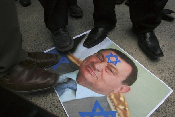 [Jordanian+demonstrators+step+on+a+picture+of+Egyptian+President+Hosni+Mubarak+during+a+protest+against+the+installation+of+an+underground+metal+barrier+at+the+border+between+Egypt+and+the+southern+Gaza+Strip.jpg]