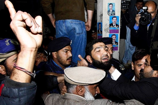Malik Mumtaz Qadri, third from right, was greeted by supporters as he