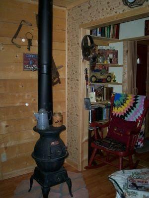 potbelly stove in den/bedroom