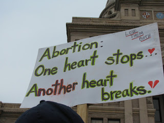 A sign read, 'Abortion: One heart stops, another heart breaks'