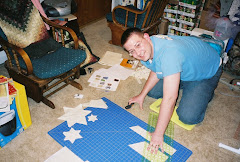 Kyle is cutting triangles for a fractal geometry quilt he made