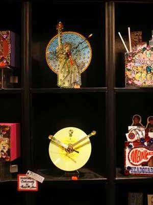 Clocks made from recylced record album covers and bejeweled by Max I. Million at Gold Million Rrecords.