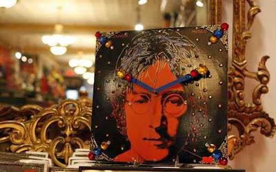 Clocks made from recycled record albums and bejeweled by Max I. Million at Gold Million Rrecords.