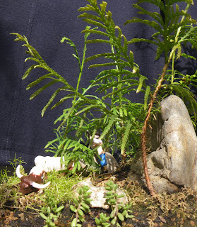 Hunting scene from Snow White Story in miniature garden