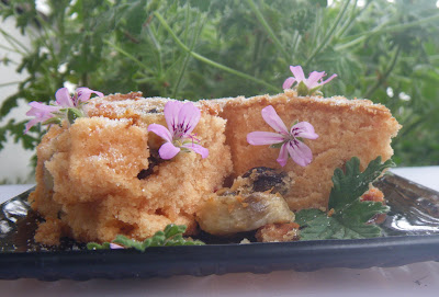 Banana Fruit Bread with rose scented pelargonium leaves